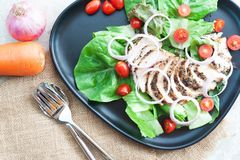 Healthy food, grilled chicken black pepper salad on concrete table. Dieting or kitchen concept. Healthy food, grilled chicken black pepper salad on concrete stock photography