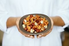 Healthy Food. Hands Holding Bowl With Nuts royalty free stock photos