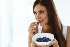 Healthy Food. Happy Woman On Diet Eating Organic Blueberries Royalty Free Stock Images