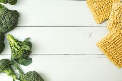 Healthy food and harmful fast food on a white table, top view. Space for text royalty free stock images