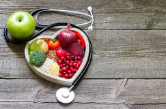 Healthy food in heart and cholesterol diet concept. On vintage boards Royalty Free Stock Photography