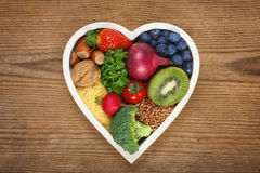Healthy food in heart shaped bowl Royalty Free Stock Photography