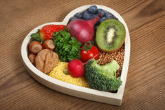 Healthy food in heart shaped bowl Royalty Free Stock Photo