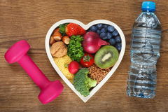 Healthy food in heart shaped bowl Stock Images