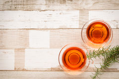 Healthy food: herbal tea and rosemary on wooden table. Healthy food arrangement with two glass cups of herbal or black tea and rosmary leaves on a rustic wooden Stock Photography