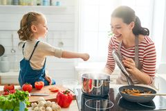 Happy family in the kitchen stock images