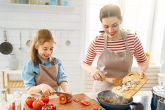Happy family in the kitchen stock photos