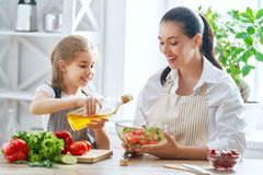 Happy family in the kitchen stock image