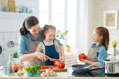 Happy family in the kitchen royalty free stock photography