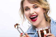 Closeup of Enticing Caucasian Blond with Ice Cream. Healthy Food Ideas and Concepts. Closeup of Enticing Caucasian Blond Girl Eating Chocolate Icecream with royalty free stock images