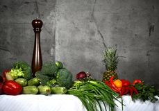 Healthy food ingredients vegetables, fruits herbs and spices. Organic vegetables on table. And concrete wall background royalty free stock image