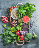 Healthy food ingredients in wooden box over grey background Stock Photos
