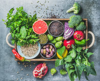 Healthy food ingredients in wooden box over grey background Royalty Free Stock Image