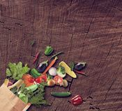 Healthy Food isolated On Wooden Background. Healthy Vegetarian Food in a paper bag On Wooden Background stock images