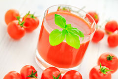 Healthy food juice red cherry tomatoes Royalty Free Stock Image