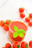 Healthy food juice red cherry tomatoes Stock Photography
