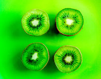Healthy food with kiwi on green tropical background top view pattern Royalty Free Stock Images