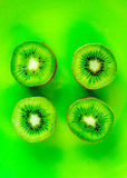 Healthy food with kiwi on green tropical background top view pattern Stock Image