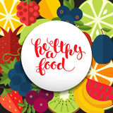 Healthy food lettering on background  of fruits. Stock Photo