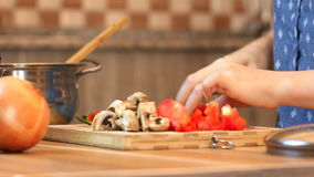 Healthy food lifestyle: beautiful woman casually. Cooking, cutting vegetables at kitchen. Medium shot, handheld, HD 1080p stock video