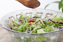 Healthy food lifestyle. Fresh salad with oil Stock Photos