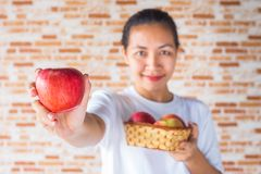 Woman with apple. Healthy food and lifestyle - woman hand holding red apple stock photography