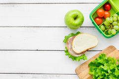 Healthy food in lunchbox for dinner at school white table background top view mockup Royalty Free Stock Photography