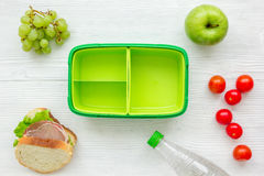 Healthy food in lunchbox for dinner at school white table background top view Stock Photo