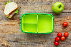 Healthy food in lunchbox for dinner at school wooden table background top view Stock Photography