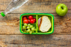 Healthy food in lunchbox for dinner at school wooden table background top view Royalty Free Stock Photography