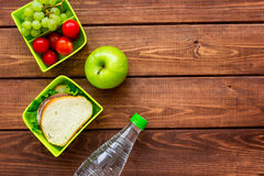 Healthy food in lunchbox for dinner at school wooden table background top view mockup Stock Photos