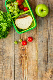 Healthy food in lunchbox for dinner at school wooden table background top view mockup Royalty Free Stock Photos