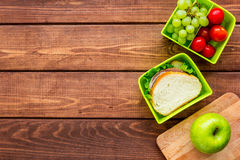 Healthy food in lunchbox for dinner at school wooden table background top view mockup Stock Images