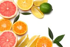 healthy food. mix sliced lemon, green lime, orange, mandarin and grapefruit with green leaf isolated on white background top view stock photos