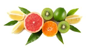 healthy food. mix sliced lemon, green lime, orange, mandarin, kiwi fruit and grapefruit with green leaf isolated on white royalty free stock images