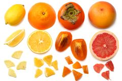 Healthy food. mix sliced lemon, persimmon, orange, mandarin and grapefruit with green leaf isolated on white background. top view Stock Images