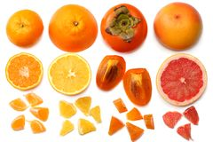 Healthy food. mix sliced lemon, persimmon, orange, mandarin and grapefruit with green leaf isolated on white background. top view Royalty Free Stock Images
