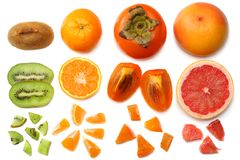 Healthy food. mix sliced persimmon, orange, mandarin, kiwi fruit and grapefruit with green leaf isolated on white background. top. View Stock Images
