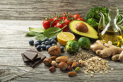 Healthy food. Mixed fresh healthy food on wooden background Royalty Free Stock Images