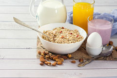 Healthy food muesli with banana, nuts and milk for breakfast Stock Photography