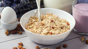 Healthy food muesli with banana, nuts and milk for breakfast Stock Photo