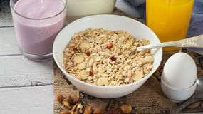 Healthy food muesli with banana, nuts and milk for breakfast Royalty Free Stock Image