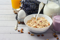 Healthy food muesli with banana, nuts and milk for breakfast Stock Images