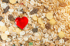 Healthy food, muesli raisins background and heart symbol Royalty Free Stock Images