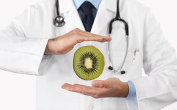 Healthy food and natural nutrition medical diet concept, hands d. Octor with kiwi fruit stock photography