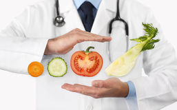 Healthy food and natural nutrition medical diet concept, hands d. Octor with vegetables stock image