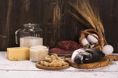 Healthy food, natural sources of protein over wooden table Stock Photography