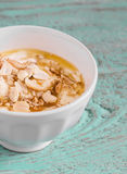 Healthy food - natural yoghurt with honey, nuts and cinnamon in a white bowl Stock Photos