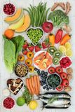 Health Food Nutrition. Healthy food nutrition concept with fresh seafood, fruit, vegetables, nuts, herbs and spice. Super foods high in omega 3 fatty acids Stock Image