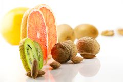 Healthy food, nutrition and diet. New trends and prospects in fitness, healthy lifestyle, sports nutrition. Ripe and mouth-watering tropical fruits and nuts Royalty Free Stock Photography
